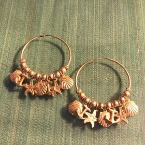Gold tone hoops with sea shells